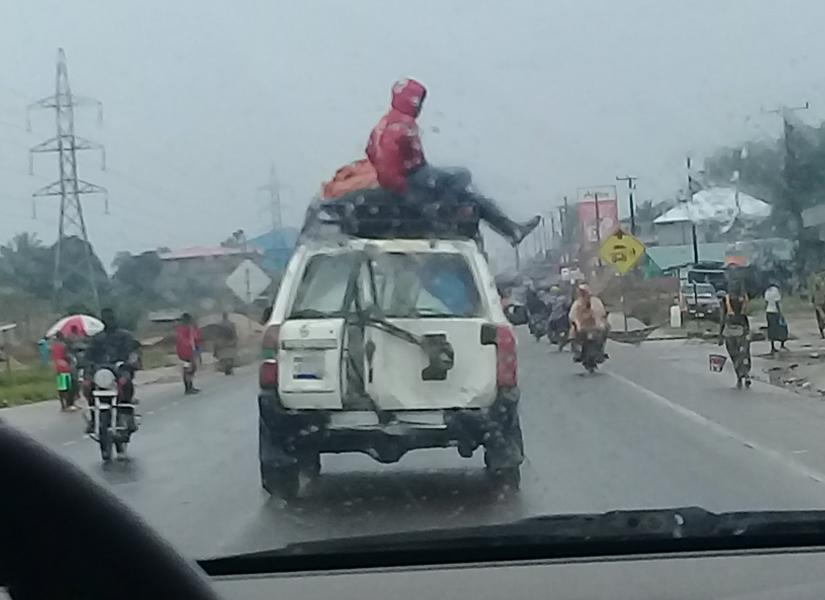 Some of the cars we meet on the roads. Yes, that's a person on the top of that car.
